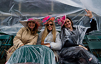 LOUISVILLE, KY - MAY 05: Women sit under cover to stay dry on Kentucky Oaks Day at Churchill Downs on May 5, 2017 in Louisville, Kentucky. (Photo by Scott Serio/Eclipse Sportswire/Getty Images)