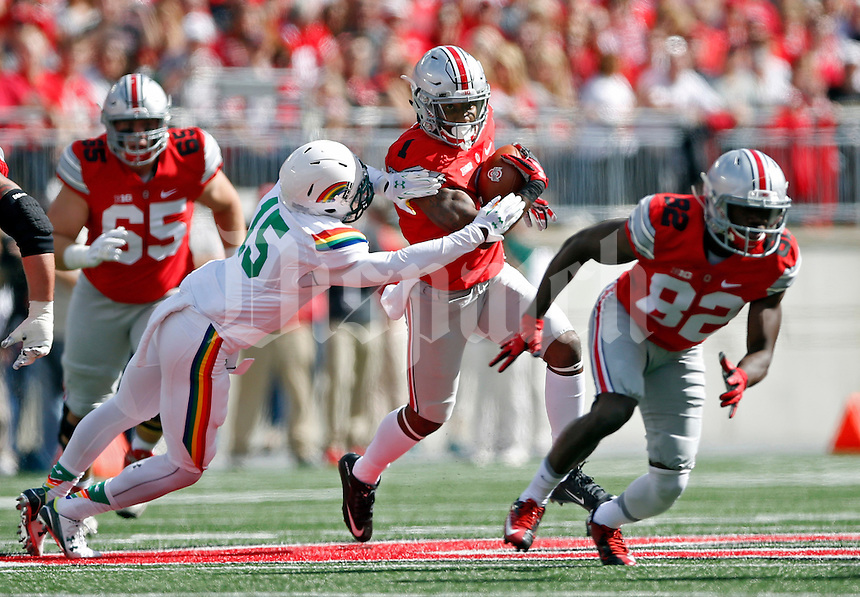 Ohio State Buckeyes wide receiver Braxton Miller (1) carries the ball past Hawaii Warriors defensive back Daniel Lewis Jr. (15) in the 1st quarter of their game against Hawaii Warriors at Ohio Stadium on September 12, 2015.  (Dispatch photo by Kyle Robertson)