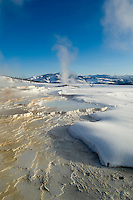 Electric Peak is background to a snowy, steamy Main Terrace-Mammoth Hot Springs