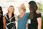 Carole Hochman, Betsey Johnson, and guest laugh on stage at the CURVE and CFDA Party For A Cause event during the CURVENY Lingerie & Swim show, at the Jacob Javits Convention Center, August 2, 2010.