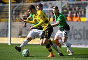 18th March 2018, Dortmund, Germany;  Football Bundesliga, Borussia Dortmund versus Hannover 96 at the Signal Iduna Park. Dortmund's Christian Pulisic (c) and Waldemar Anton (l) challenge Matthias Ostrzolek of Hanover for the ball.