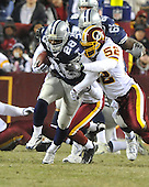 Landover, MD - December 27, 2009 -- Dallas Cowboys running back Felix Jones (28) is tackled by Washington Redskins linebacker Rocky McIntosh (52) in game action at FedEx Field in Landover, Maryland on Sunday, December 27, 2009..Credit: Ron Sachs / CNP.(RESTRICTION: NO New York or New Jersey Newspapers or newspapers within a 75 mile radius of New York City)