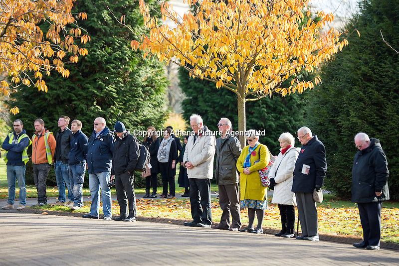 Pictured: People observe a minute's silence at the cenotaph at the cenotaph Friday 11 November 2016<br /> Re: Remembrance Day service at the Cenotaph in Cardiff, south Wales, UK.
