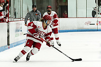 BOSTON, MA - JANUARY 04: Deziray De Sousa #8 of Boston University brings the puck forward during a game between University of Maine and Boston University at Walter Brown Arena on January 04, 2020 in Boston, Massachusetts.