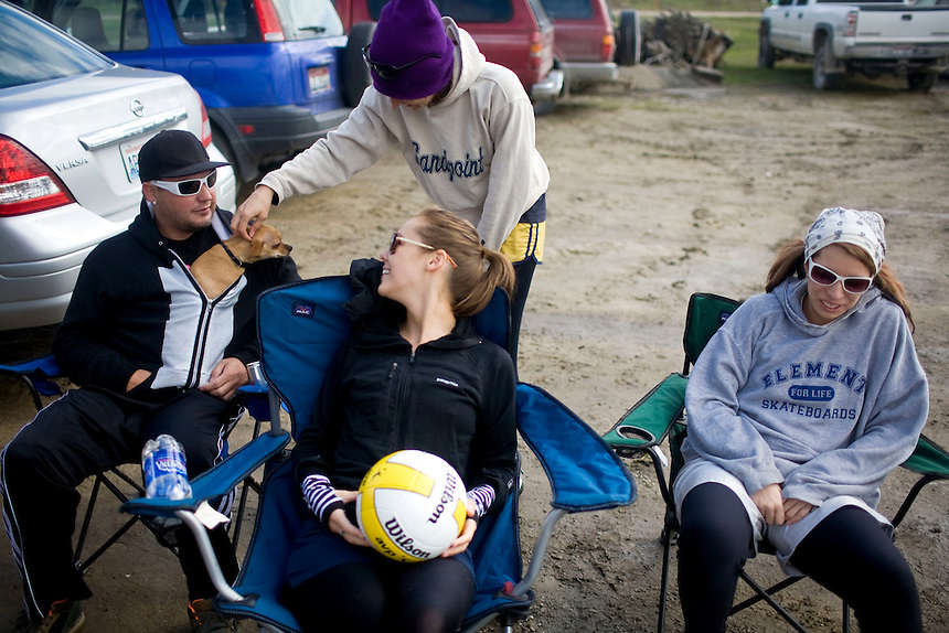 Team Muddy Balls sits in the parking lot during the 2011 Mud Volleyball Tournament in Laclede, ID sponsored by the Kodiak Bar. .(©Matt Mills McKnight/2011)