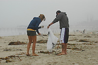 Amanda Spanier and Ryan Sholty search for trash on Mission Beach July 5th, 2008.  Volunteers and organisers of several beach clean-ups in the Pacific and Mission Beach area were stunned by the huge reduction in trash on the beaches compared to what they are used to finding each year on July 5th in the wake of the thousands of beachgoers that crowd the area on the Fourth of July holiday.  The cleanliness of the beaches left many searching the side streets and alleys for trash to collect.  Most people are attributing the drastic change to the six-month old alcohol ban on the area beaches.