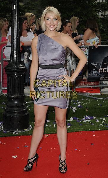 "ALI BASTIAN .UK Gala Premiere of ""The Twilight Saga: Eclipse"" at the Odeon Leicester Square, London, England, UK, July 1st 2010. .full length purple lilac grey gray silver dress one shoulder hand on hip black shoes sandals cut out peep toe waistband .CAP/CAN.©Can Nguyen/Capital Pictures."