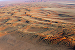Namibia, Namib Desert, Namibrand Nature Reserve, aerial of red sand dunes covered with vegetation
