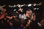 Various photographs of people attending a rock concert.