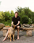 June 30, 2016. Blacksburg, Virginia. <br />  After his daily run, Marc Edwards cools down with his dog Curry at the fire pit beside his home. An avid runner, Edwards runs approximately 40 miles a week on the trails and roads surrounding his home outside Blacksburg, VA. <br />  Marc Edwards is a civil engineering/environmental engineer and the Charles P. Lunsford Professor of Civil and Environmental Engineering at Virginia Tech. He is an expert in water quality and corrosion, and his work in Washington DC  and in Flint, Michigan helped to expose high levels of lead contamination in the water supplies of those two cities, triggering investigations into the cause of the pollution.