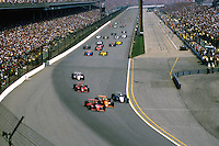 INDIANAPOLIS, IN - MAY 26: Bobby Rahal, driving the Budweiser March 85C 11/Cosworth, takes the lead as the field races into Turn 1 at the start of the Indianapolis 500 at the Indianapolis Motor Speedway in Indianapolis, Indiana, on May 26, 1985..