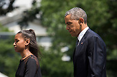 From left, Sasha Obama and United States President Barack Obama exit Marine One and walk toward the residence of the White House on the South Lawn, on June 6, 2015, in Washington, DC. President Obama traveled to Wilmington, Delaware Saturday morning to deliver the eulogy at Beau Biden's funeral.<br /> Credit: Drew Angerer / Pool via CNP