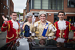 © Joel Goodman - 07973 332324 . 24 August 2013 . Manchester , UK . The Queen with footmen . 2013 Gay Pride Parade through Manchester City Centre . This year's theme is 1980s . Photo credit : Joel Goodman