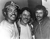 "Reggie Jackson, Dick Williams and Jim ""Catfish"" Hunter celebrate after winning the 1973 World Series.(photo 1973 copyright/Ron Riesterer)"