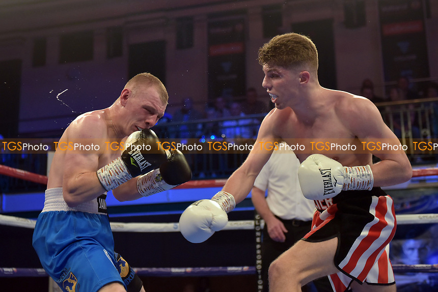 Jack Hillier (red/white shorts) defeats Piotr Jaworek during a Boxing Show at York Hall on 13th October 2018