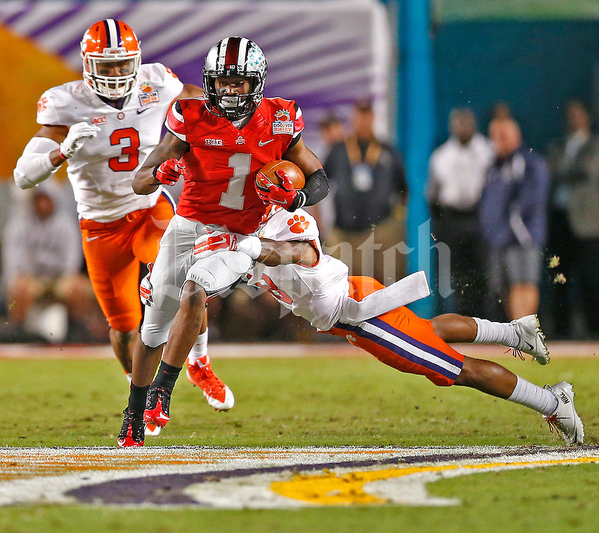 Ohio State Buckeyes running back Dontre Wilson (1) gains yardage in the first quarter against Clemson in the 2014 Discover Orange Bowl at Sun Life Stadium in Miami Gardens, Florida on January 3, 2014. (Chris Russell/Dispatch Photo)
