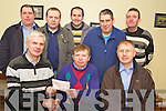 Ballyhar Dynamos club chairman Donal Groves presents Donie Teahan with his winning lotto cheque of EUR4,500 at Ballyhar Dynamos clubhouse on Thursday night. Also pictured are Timmy Teahan, John Joe Dowd, Brendan O'Sullivan, Donal O'Donoghue, Liam Barry and John Kerrisk....NO REPRODUCTION FEE.....