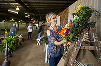 NWA Democrat-Gazette/BEN GOFF @NWABENGOFF<br /> Jill Rotrekel of Bella Vista helps set up a display at the entrance Wednesday, April 10, 2019, while preparing for Vintage Market Days Northwest Arkansas at the Benton County Fairgrounds in Bentonville. Rotrekel and three others who sell at The Rose Antique Mall and Flea Market in Rogers were setting up the display and will also have their own booths at the show. Vintage Market Days, with rustic repurposed furniture and decor items, original arts, crafts, clothing and food trucks will be open Friday through Sunday.