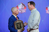 Canton, OH - August 6, 2016: Former NFL quarterback Peyton Manning speaks with ESPN's Chris Mortensen backstage at the Pro Football Hall of Fame Enshrinement Ceremony in Canton, Ohio, August 6, 2016. Mortensen received the Dick McCann Award for his distinguished career in sports journalism.  (Photo by Don Baxter/Media Images International)