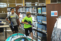 NWA Democrat-Gazette/MICHAEL WOODS &bull; @NWAMICHAELW<br /> Jade Jones, (from left), 12,  and Dylan Osborne, 11, both from Fayetteville, try to sneak up on their opponents during a laser tag game Friday, August 7, 2015, at the Fayetteville Public Library.  The after hours later tag games were part of the Teen Summer Reading Finale Party that included a variety of games, prizes and snacks for kids who completed grades 6 through 12.