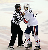 February 22nd 2008:  Mike Funk (4) of the Rochester Amerks is restrained by linesman Jeff Walker (17) during a game vs. the Binghamton Senators at Blue Cross Arena at the War Memorial in Rochester, NY.  The Senators defeated the Amerks 4-0.   Photo copyright Mike Janes Photography