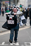 Man selling Swansea tee-shirts as Swansea City Football team celebrate during an open-top bus parade through the centre of Swansea after beating Bradford City 5-0 in Sunday's Capital One Cup final at Wembley to win the Capital Cup trophy.