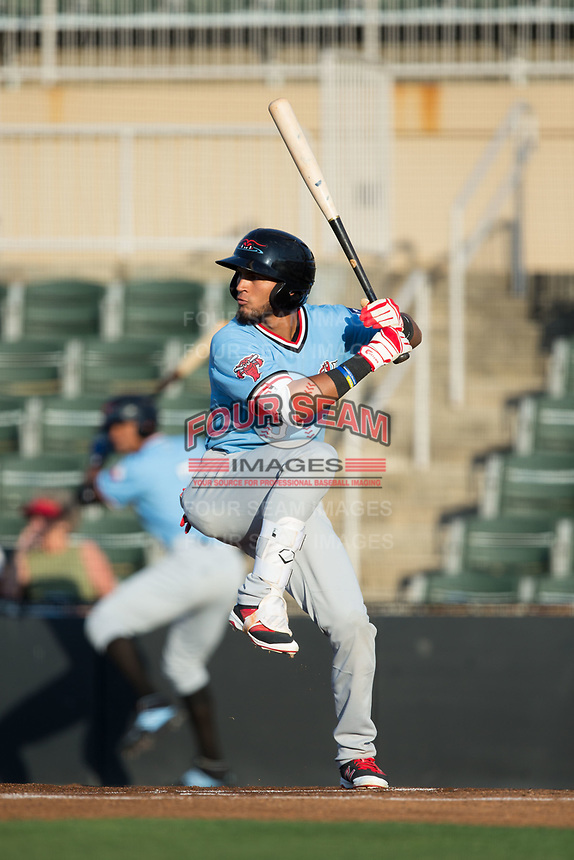 Miguel Aparicio (5) of the Hickory Crawdads at bat against the Kannapolis Intimidators at Kannapolis Intimidators Stadium on May 18, 2017 in Kannapolis, North Carolina.  The Crawdads defeated the Intimidators 6-4.  (Brian Westerholt/Four Seam Images)
