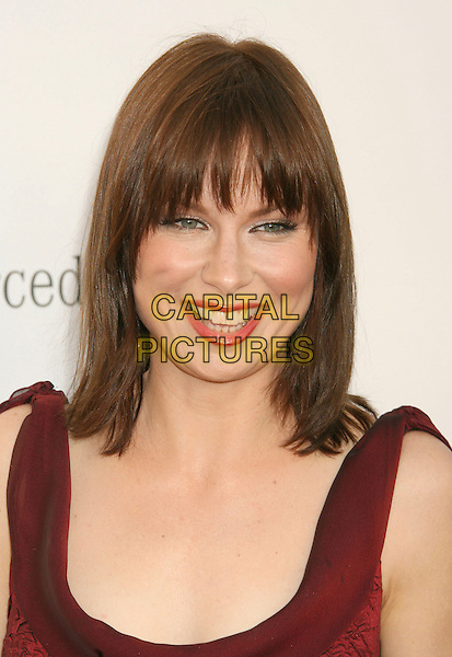 MARY LYNN RAJSKUB.Sixth Annual Chrysalis Butterfly Ball held at the Home of Susan Harris and Hayward Kaiser, Mandeville Canyon, California, USA, 02 June 2007..portrait headshot smiling fringe red lipstick.CAP/ADM/RE.©Russ Elliot/AdMedia/Capital Pictures. *** Local Caption *** ..