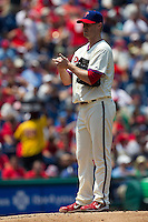 Philadelphia Phillies pitcher Kyle Kendrick #38 rubs the baseball after allowing a pair of first inning home runs during the Major League Baseball game against the Pittsburgh Pirates on June 28, 2012 at Citizens Bank Park in Philadelphia, Pennsylvania. The Pirates defeated the Phillies 5-4. (Andrew Woolley/Four Seam Images).