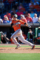 Baltimore Orioles first baseman Ryan Mountcastle (76) follows through on a swing during a Grapefruit League Spring Training game against the Philadelphia Phillies on February 28, 2019 at Spectrum Field in Clearwater, Florida.  Orioles tied the Phillies 5-5.  (Mike Janes/Four Seam Images)