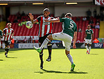 Leon Clarke of Sheffield Utd in action with Andreas Bjelland of Brentford during the English championship league match at Bramall Lane Stadium, Sheffield. Picture date 5th August 2017. Picture credit should read: Jamie Tyerman/Sportimage
