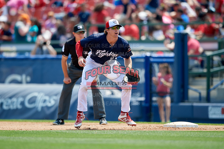 Reading Fightin Phils first baseman Zach Green (12) and first base umpire Derek Gonzales during the first game of a doubleheader against the Portland Sea Dogs on May 15, 2018 at FirstEnergy Stadium in Reading, Pennsylvania.  Portland defeated Reading 8-4.  (Mike Janes/Four Seam Images)