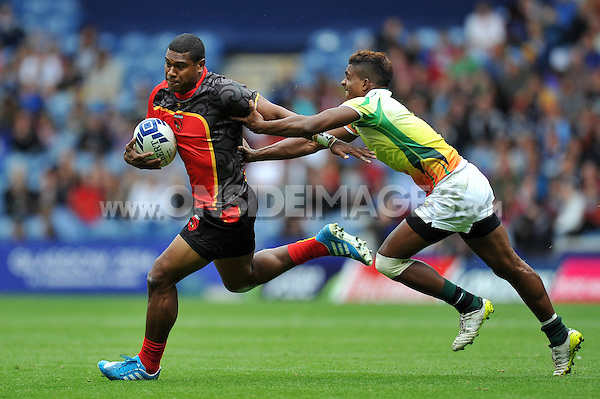 Stanis Susuve of Papua New Guinea in action in the Men's Rugby Sevens Bowl Quarter-final between Papua New Guinea and Sri Lanka. Day four, Glasgow 2014 Commonwealth Games, Rugby Sevens, on July 27, 2014 at the Ibrox Stadium in Glasgow, Scotland. Photo by: Patrick Khachfe / Onside Images