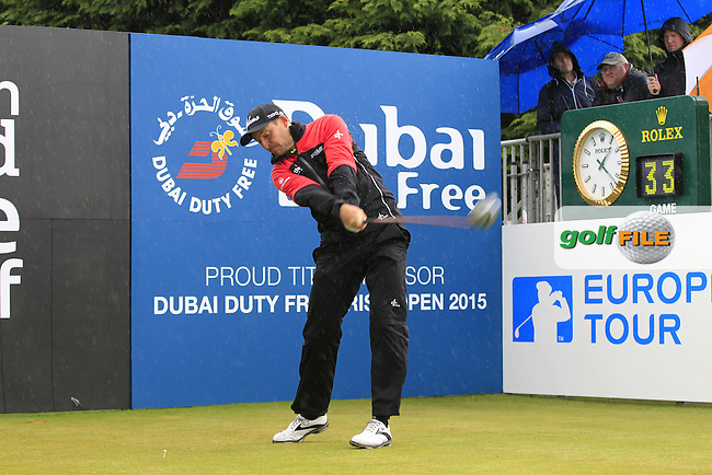 David HOWELL (ENG) tees off the 1st tee during the Pro-Am of the 2015 Dubai Duty Free Irish Open, Royal County Down Golf Club, Newcastle Co Down, Northern Ireland. 27/05/2015 <br /> Picture Eoin Clarke, www.golffile.ie