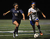 Kate Fiola #20 of Massapequa, left, and Kayla Leary #19 of East Meadow battle for possession during the Nassau County varsity girls soccer Class AA semifinals at Cold Spring Harbor High School on Monday, Oct. 30, 2017. Fiola scored a goal in each half to give Massapequa a 2-0 lead.