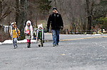 Middlebury, CT- 27 December 2013-122813CM01-  Left to right, Alex, 5, Ciana, 7, and Matthew Chirkout, 4, walk with their dad, VJ Chirkout of Naugatuck inside Hop Brook recreation area in Middlebury Saturday morning.  The children kept warm by wearing various headwear. Alex was wearing a tiger hat, Ciana a bunny and Alex a husky.  VJ Chirkout said he was taking his kids for a walk as his wife went for a spa treatment.  Although Saturday was mild, according to the National Weather Service, on Sunday there is a slight chance of rain and snow between 9 a.m. and noon, with a high near 40.   Christopher Massa Republican-American