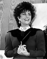 Actress Elizabeth Taylor at Macy's in San Francisco, California introducing her new line of perfume. (1987 photo by Ron Riesterer).