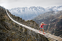 Crossing the Salbit hanging bridge while on a trail running tour through the area, Switzerland.