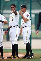 GCL Pirates designated hitter Joseivin Medina (32) and pitcher Noe Toribio (35) after the second game of a doubleheader against the GCL Yankees East on July 31, 2018 at Pirate City Complex in Bradenton, Florida.  GCL Pirates defeated GCL Yankees East 12-4.  (Mike Janes/Four Seam Images)