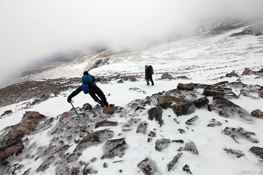 Two climbers tackle the icy talus fields near the summit of James Peak, in the James Peak Wilderness, Colorado.