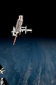 This image of the International Space Station and the docked space shuttle Endeavour, flying at an altitude of approximately 220 miles, was taken by Expedition 27 crew member Paolo Nespoli from the Soyuz TMA-20 following its undocking on May 23, 2011 (USA time). The pictures taken by Nespoli are the first taken of a shuttle docked to the International Space Station from the perspective of a Russian Soyuz spacecraft. Onboard the Soyuz were Russian cosmonaut and Expedition 27 commander Dmitry Kondratyev; Nespoli, a European Space Agency astronaut; and NASA astronaut Cady Coleman. Coleman and Nespoli were both flight engineers. The three landed in Kazakhstan later that day, completing 159 days in space..Credit: NASA via CNP