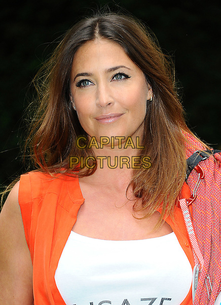 Lisa Snowdon.Photocall for Vodafone JustTextGiving Charity Challenges, London, England..5th September 2011.headshot portrait white top orange rope.CAP/CJ.©Chris Joseph/Capital Pictures.