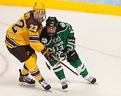 Travis Boyd (MN - 22), Connor Gaarder (North Dakota - 13) - The University of Minnesota Golden Gophers defeated the University of North Dakota 2-1 on Thursday, April 10, 2014, at the Wells Fargo Center in Philadelphia to advance to the Frozen Four final.