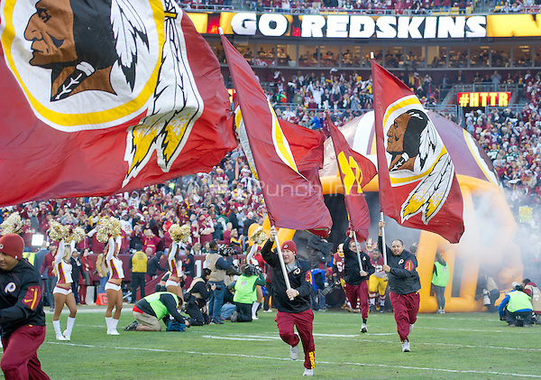 The Washington Redskins flag carriers run onto the field as the team is introduced prior to the NFC Wild Card game against the Green Bay Packers at FedEx Field in Landover, Maryland on Sunday, January 10, 2016.<br /> Credit: Ron Sachs / CNP/MediaPunch ***FOR EDITORIAL USE ONLY***