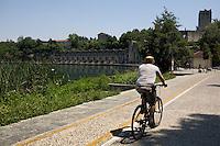 La centrale idroelettrica Taccani a Trezzo vista dalla pista ciclabile...Hydroelectric plant Taccani in Trezzo, view from cycle path along Adda river.
