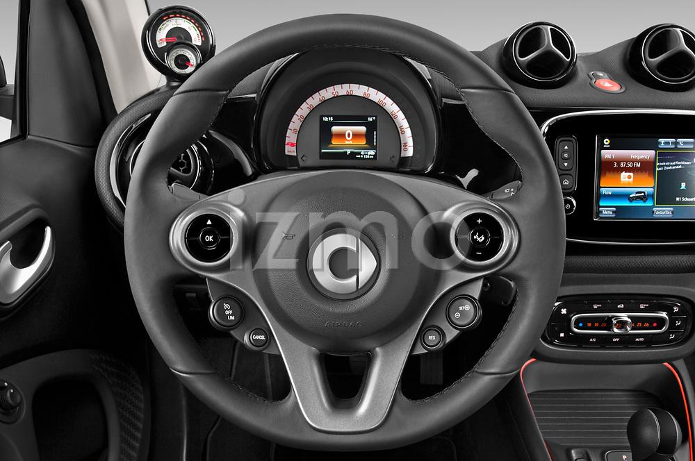 Car pictures of steering wheel view of a 2020 Smart EQ-fortwo Comfort-Plus 3 Door Hatchback Steering Wheel
