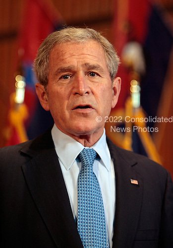 WASHINGTON - DECEMBER 20:  (AFP OUT) U.S. President George W. Bush makes a statement after visiting injured troops at Walter Reed Army Medical Center December 20, 2007 in Washington, DC. The visit was closed to the press and follows a visit to The National Naval Medical Center in Bethesda, Maryland, the previous day.  (Photo by Chip Somodevilla/Getty Images)