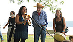 """Pete Seeger, with Joanne Shenandoah (left) and Margo Thunderbird (right), conducting a """"River Blessing"""" Ceremony near the Hudson River Shoreline during the Clearwater's Great Hudson River Revival Music & Environmental Festival 2011 at Croton Point Park, Croton-on-Hudson, NY on Saturday June 18, 2011. Photo copyright Jim Peppler/2011."""