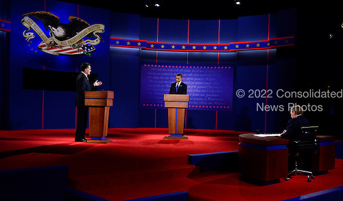 United States President Barack Obama, the Democratic Party nominee for President, and former Massachusetts Governor Mitt Romney, the Republican Party nominee for President, face-off in the first Presidential Debate of the 2012 General Election at the University of Denver in Denver, Colorado on Tuesday, October 2, 2012..Credit: Ron Sachs / CNP.(RESTRICTION: NO New York or New Jersey Newspapers or newspapers within a 75 mile radius of New York City)