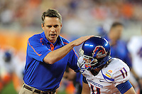 Jan. 4, 2010; Glendale, AZ, USA; Boise State Broncos head coach Chris Petersen greets quarterback (11) Kellen Moore prior to the game against the TCU Horned Frogs in the 2010 Fiesta Bowl at University of Phoenix Stadium. Boise State defeated TCU 17-10. Mandatory Credit: Mark J. Rebilas-